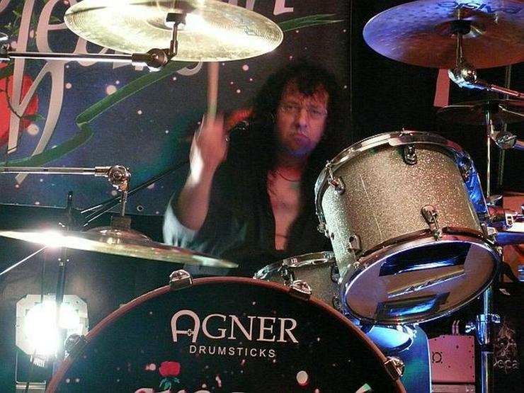 Erteile Schlagzeugunterricht