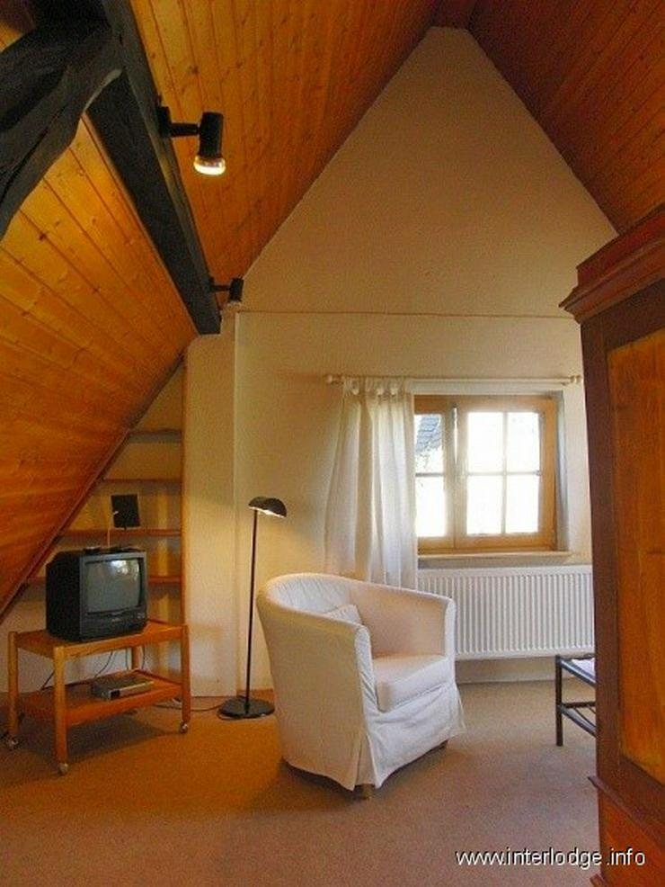 Bild 2: INTERLODGE Im Landhausstil eingerichtetes Giebel-Apartment in Essen-Stadtwald.