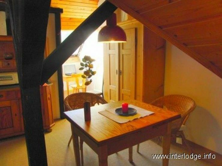 Bild 4: INTERLODGE Im Landhausstil eingerichtetes Giebel-Apartment in Essen-Stadtwald.