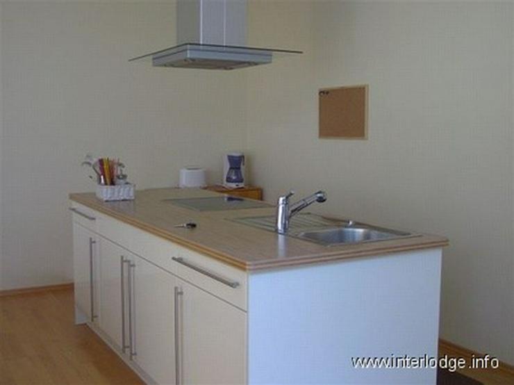 Bild 5: INTERLODGE Modern möblierte Wohnung in Bochum-Laer mit Terrassennutzung und Gartenmitbenu...