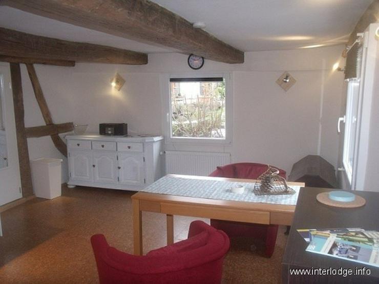 Bild 4: INTERLODGE Schick möbliertes Apartment im Fachwerkhaus mit Terrasse, Garten und Sauna in ...