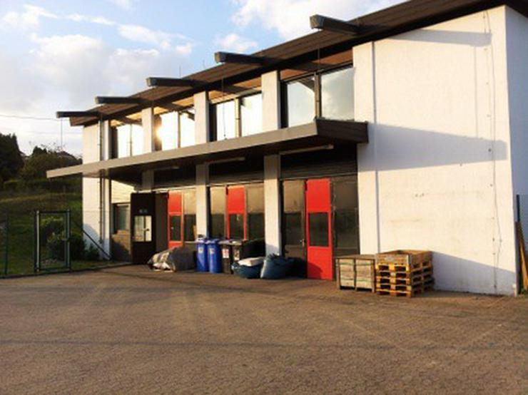 Bild 2: Geschäftshaus mit namhaftem Mieter in einer Teilfläche