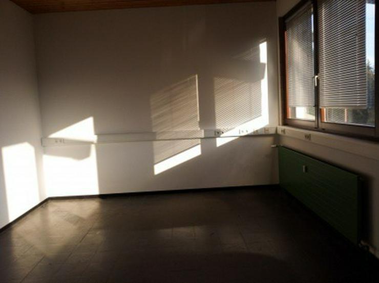 Bild 3: Geschäftshaus mit namhaftem Mieter in einer Teilfläche