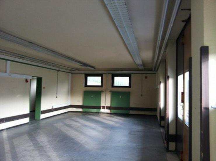 Bild 4: Geschäftshaus mit namhaftem Mieter in einer Teilfläche