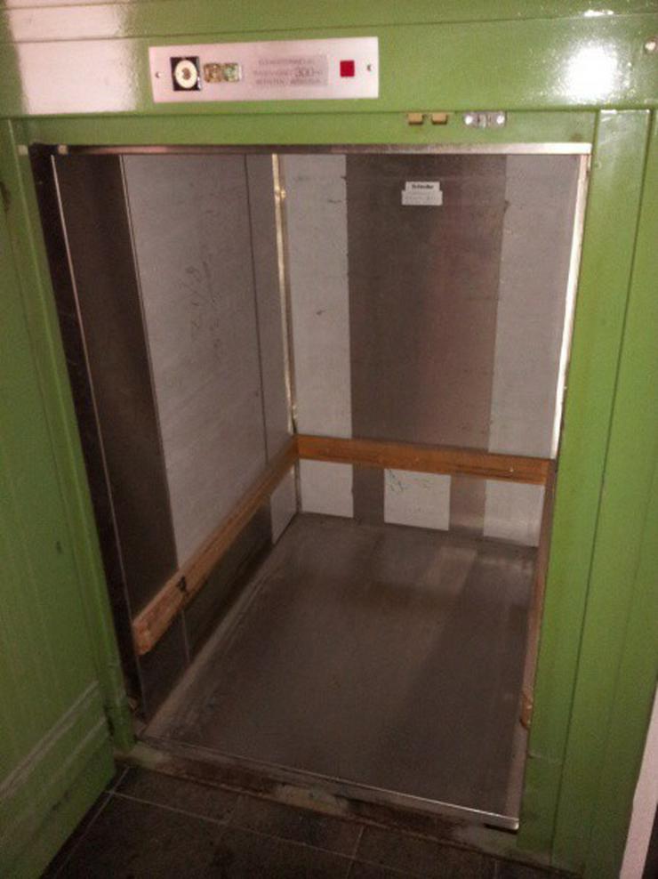 Bild 5: Geschäftshaus mit namhaftem Mieter in einer Teilfläche