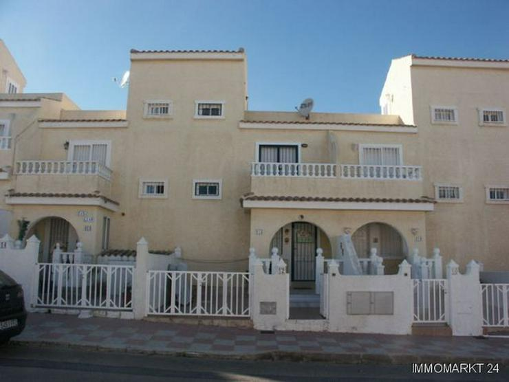 Reihenhaus mit Dachterrasse und Gemeinschaftspool - Haus kaufen - Bild 1