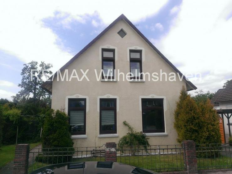 RE/MAX Wilhelmshaven: Einfamilienhaus in zentraler Lage in Varel - Haus kaufen - Bild 1
