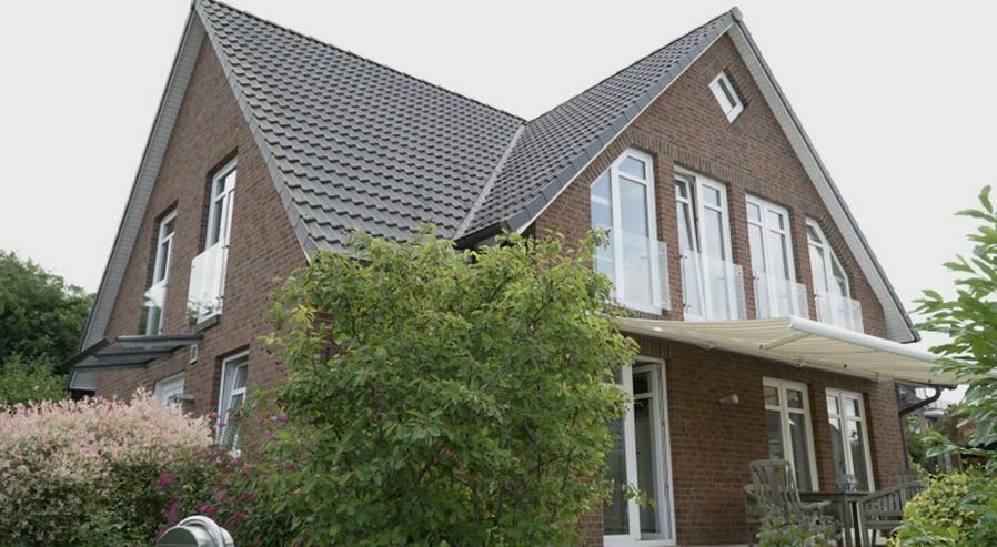 Bild 1: Familienfreundliches Architektenhaus in ruhiger Ortsrandlage