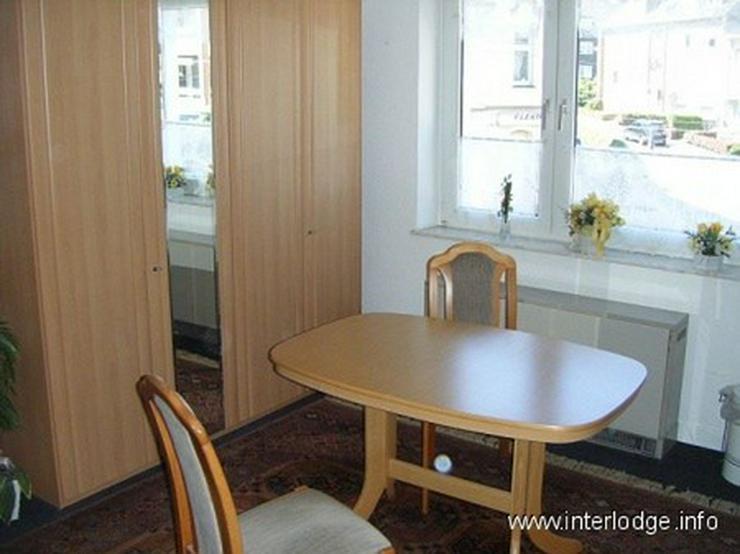 Bild 2: INTERLODGE Zweckmäßig eingerichtetes Gästezimmer in Essen-Borbeck