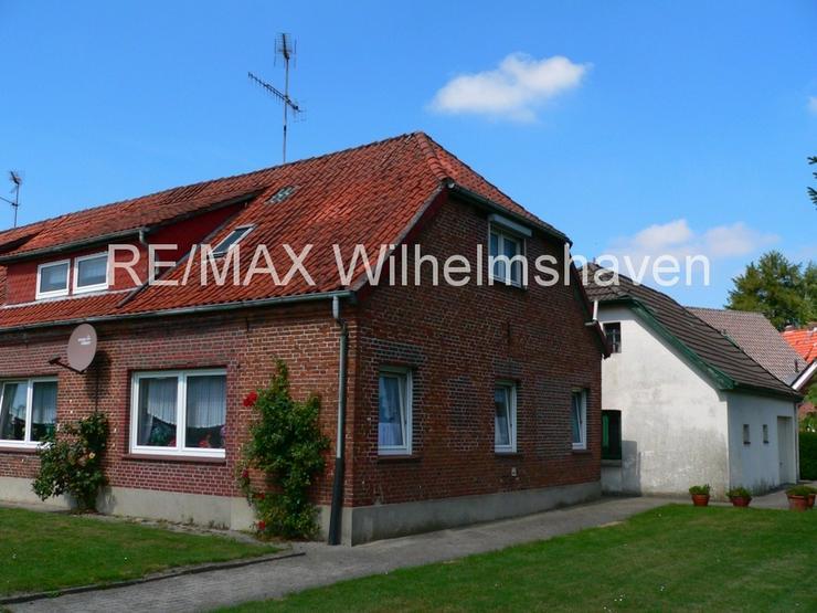 Bild 5: RE/MAX bietet an: Doppelhaushälfte für den Handwerker!