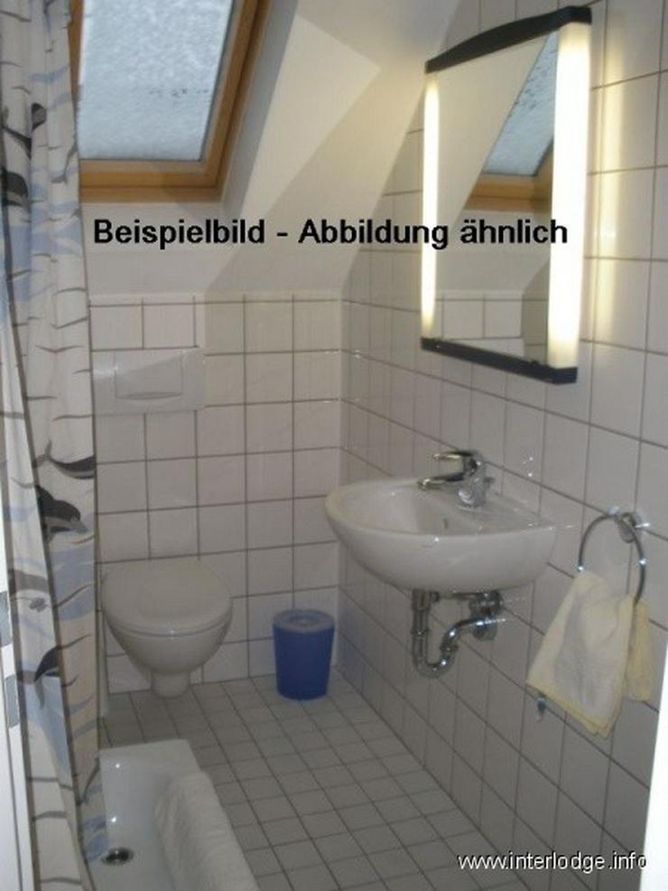 Bild 4: INTERLODGE Modern möblierte Wohnung in Bochum-City, Schlafzimmer mit 2 Einzelbetten.
