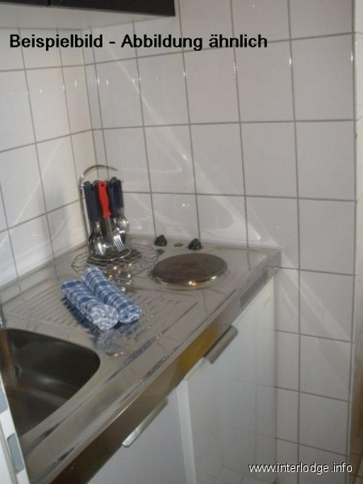 Bild 3: INTERLODGE Modern möblierte Wohnung in Bochum-City, Schlafzimmer mit 2 Einzelbetten.