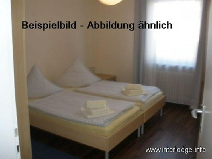 Bild 2: INTERLODGE Modern möblierte Wohnung in Bochum-City, Schlafzimmer mit 2 Einzelbetten.