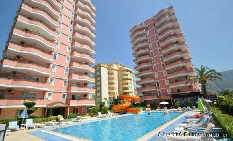 Weit geschnittene Ferienwohnung in Mahmutlar - Alanya zu verkaufen - Wohnung kaufen - Bild 1