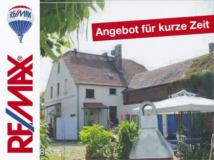 Vierseitenhof mit großem Grundstück - Haus kaufen - Bild 1