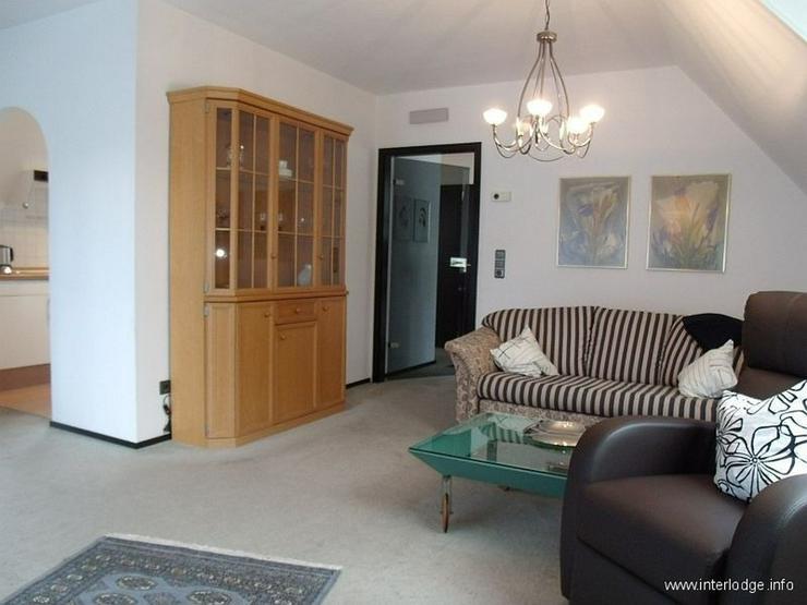 Bild 2: INTERLODGE Komfortabel eingerichtete Wohnung in gepflegter Ein-Zweifamilienhaussiedlung in...