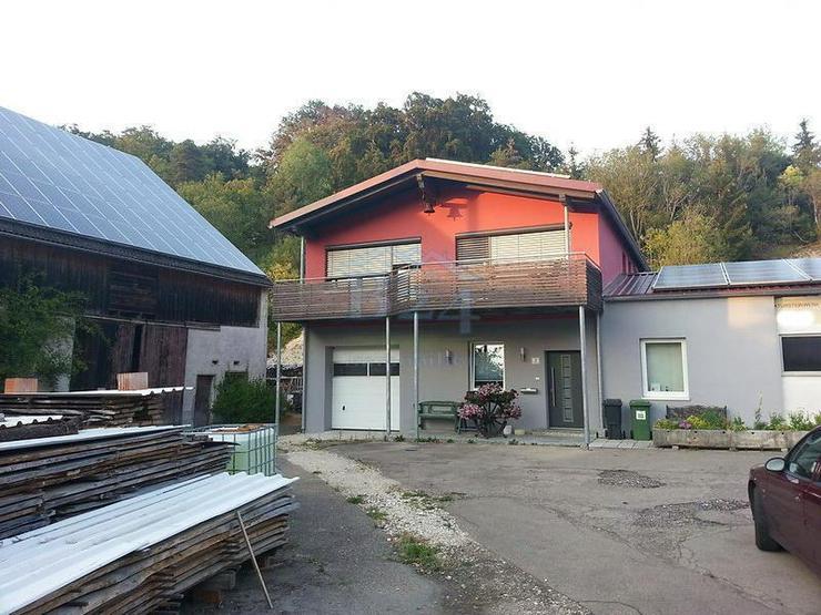 Drei Lagerhallen und ein Einfamilienhaus