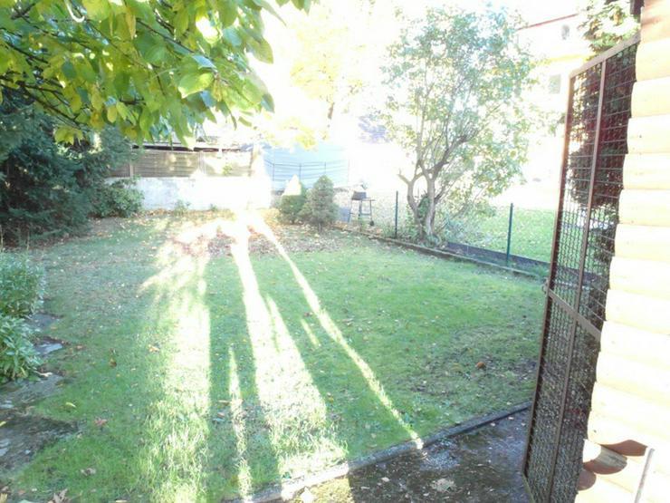 Bild 3: Eigentumswohnung im EG mit Terrasse und Garten