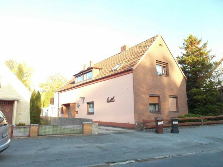 Eigentumswohnung im EG mit Terrasse und Garten - Wohnung kaufen - Bild 1