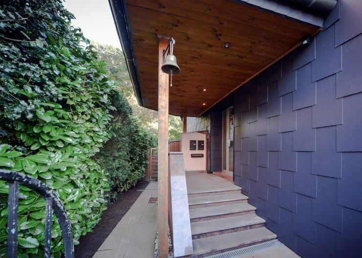 Tolles 2 Familienhaus mit freier Gartenwohnung und Blick in den angrenzenden Ruhrpark! - Haus kaufen - Bild 1