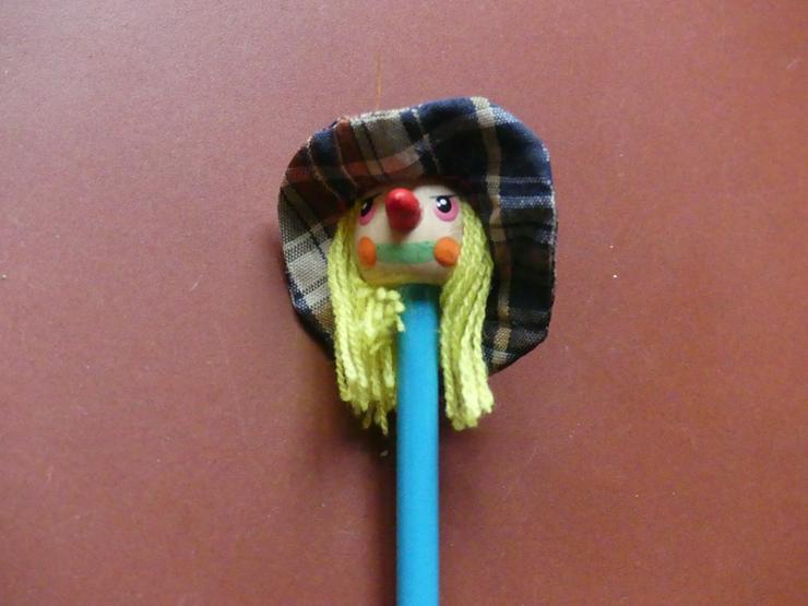 Bleistift mit Kopf