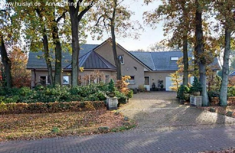 Anne Elfring Immobilien bietet an:Einfamilienhaus mit wunderschöner Garten. - Haus kaufen - Bild 1