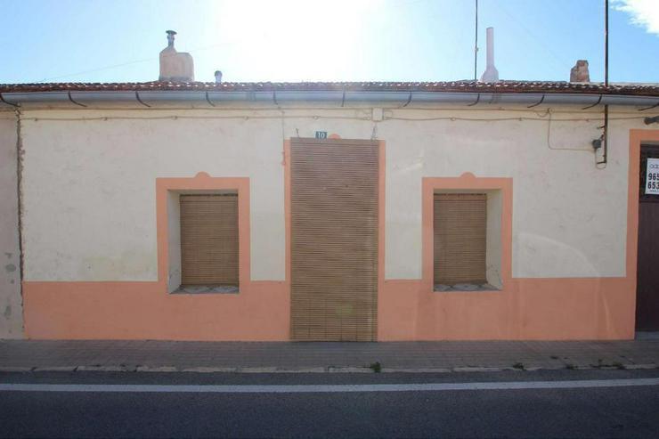 Bild 1: Typisches Dorfhaus