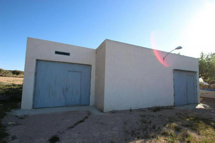 Doppelgarage mit Bauland - Haus kaufen - Bild 1
