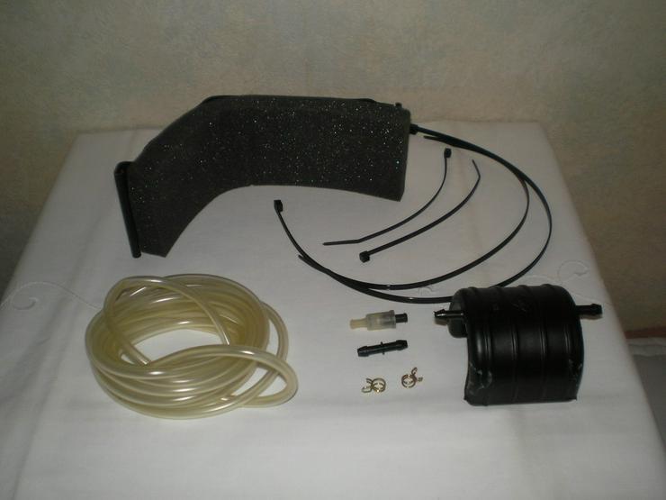 Bild 3: Handlampe, Radschlüssel, Warmwasser, Ladegerät