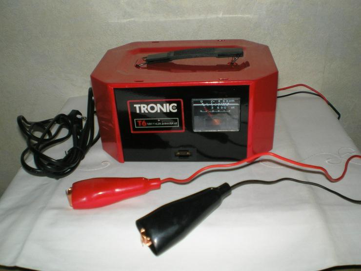 Bild 4: Handlampe, Radschlüssel, Warmwasser, Ladegerät