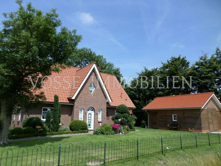 Neuwertiges Dreigiebelhaus in ländlicher Alleinlage nahe Fischerdorf Ditzum - Haus kaufen - Bild 1