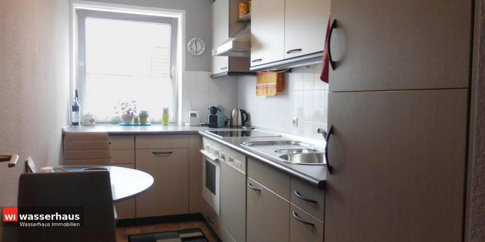 Bild 7: 2 Zimmer mit Südbalkon, EBK, Bad mit Wanne und extra breiten TG Stellplatz