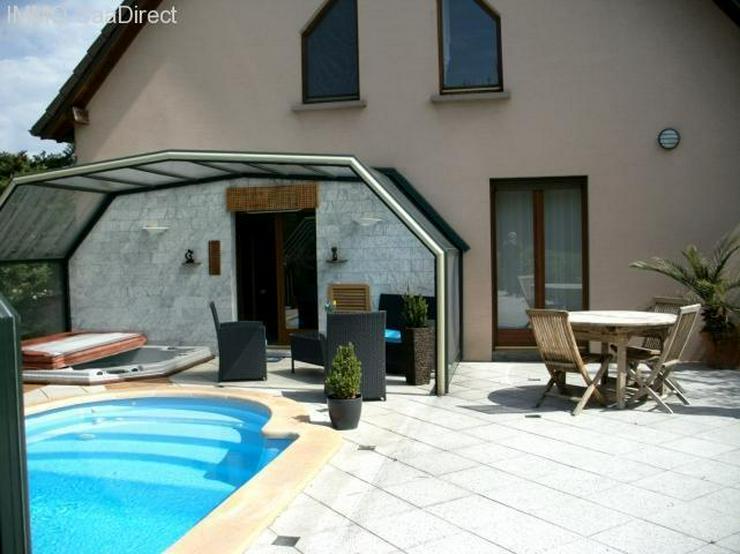 Grosszügiges Einfamilienhaus am Rhein mit beheiztem Hallenbad, Whirlpool, Geothermie u. v...