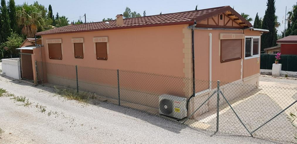 Bild 5: Mobilheim mit Gästehaus und Wirtschaftshaus