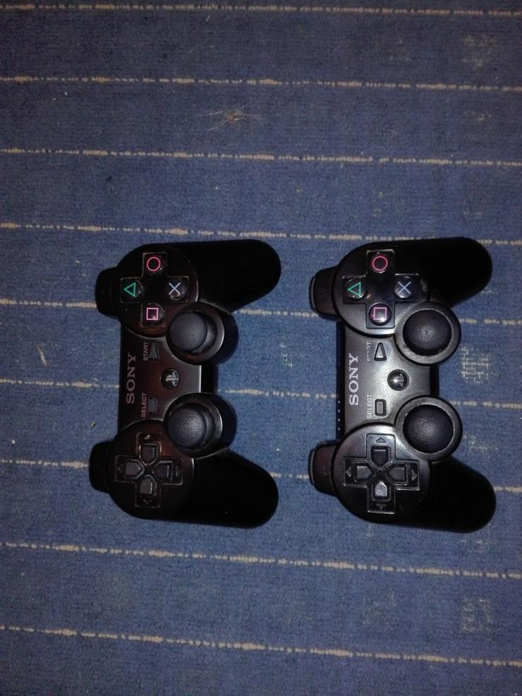 Bild 4: PS3 slim + 2 Controller + Spiele (120€ VB)