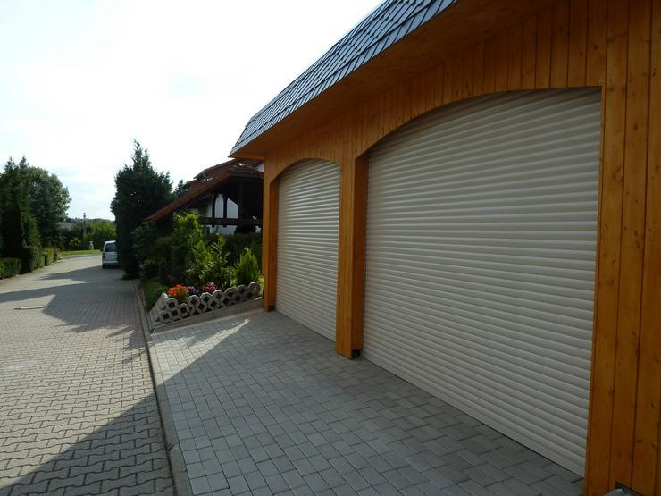 2 Garagenrolltore mit Fernbedienung - Bild 1