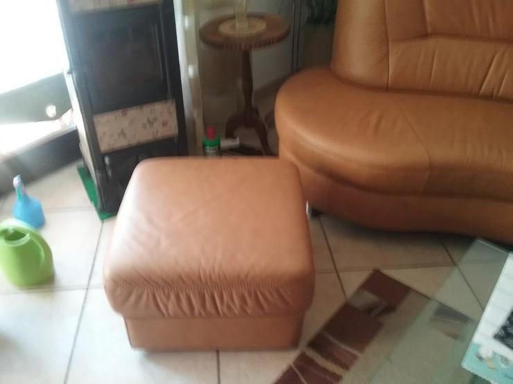 Ecksofa mit Sitzhocker in Leder