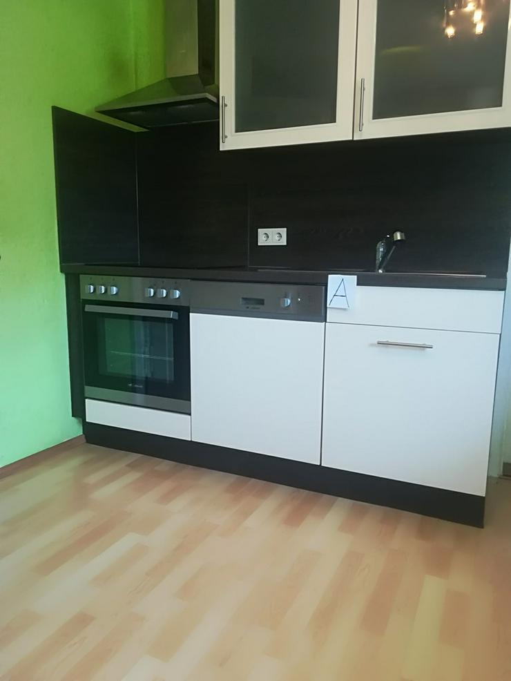 Bild 4: Küche mit Herd,Spülmaschine,Kühlschrank