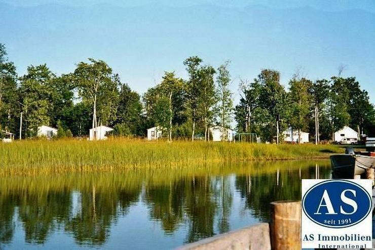 Natur Pur., ca. 50.000 qm Grundstück mit 8 Häuser direkt am See zu verkaufen! - Auslandsimmobilien - Bild 1