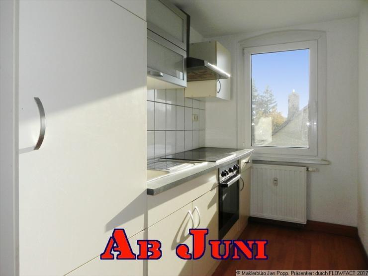 Etagenwohnung mit Einbauküche und Dachschrägen