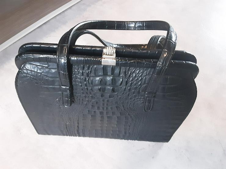 Echte alte Krokodillederhandtasche