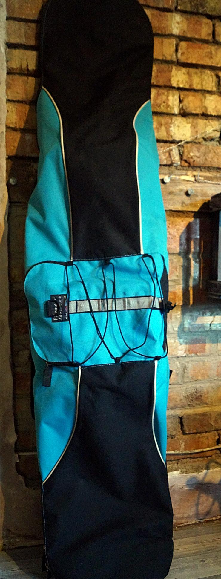 Bild 5: Snowboard mit Bindung und Tasche