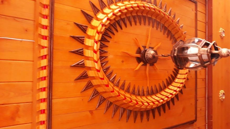 Bild 4: Holzverzierung der sonne