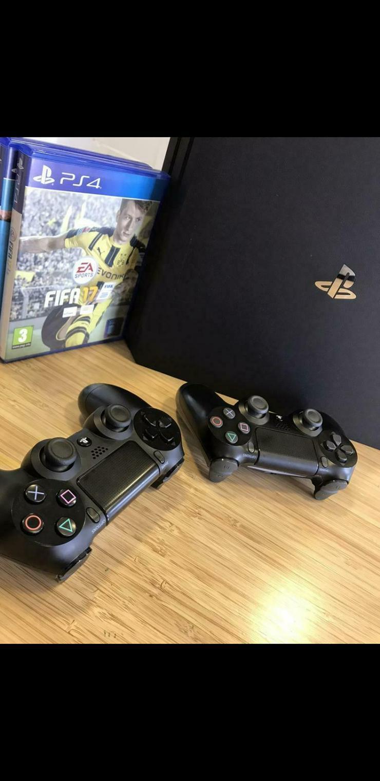 PS4 Pro - 2manettes - 2 Spiele