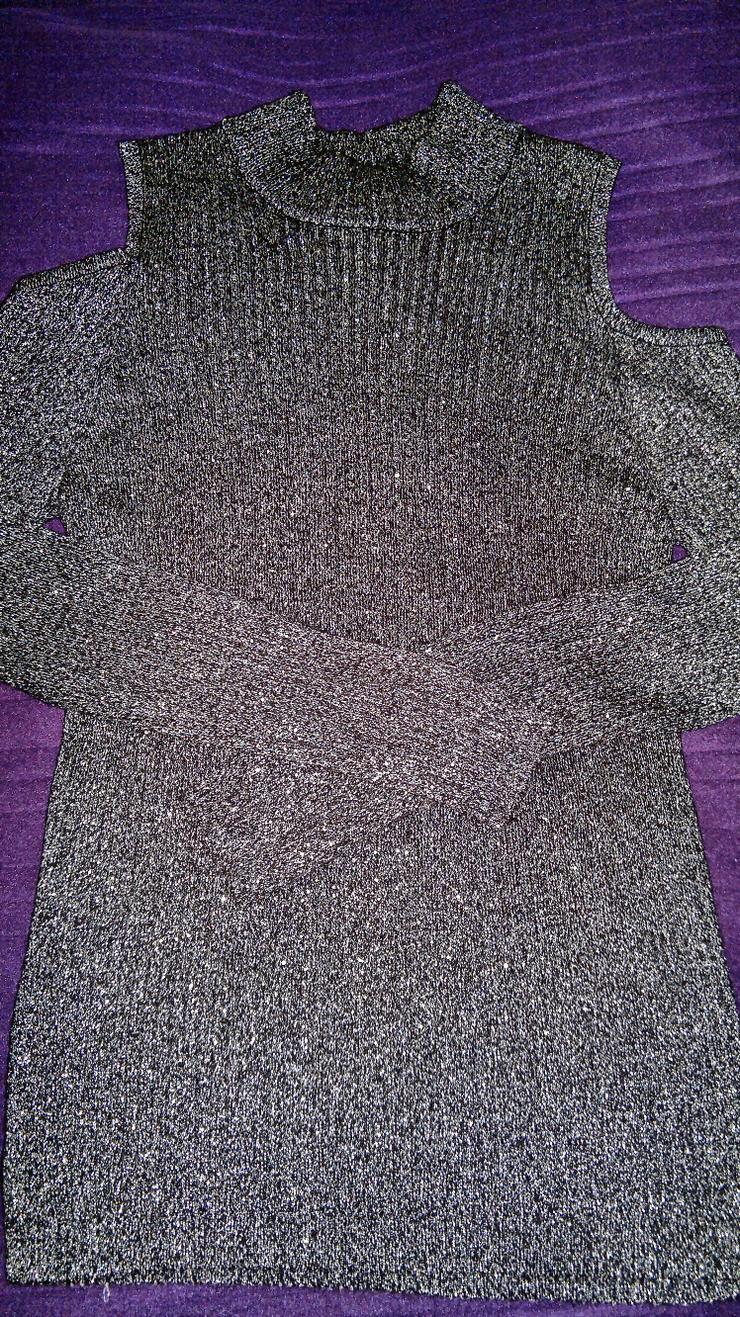 Eleganter Pullover schwarz mit Glitzereffekt und Cut-Outs Ärmel
