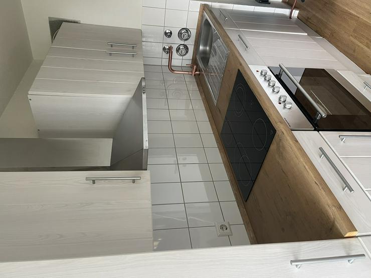 Bild 2: Landhausküche mit Geräten